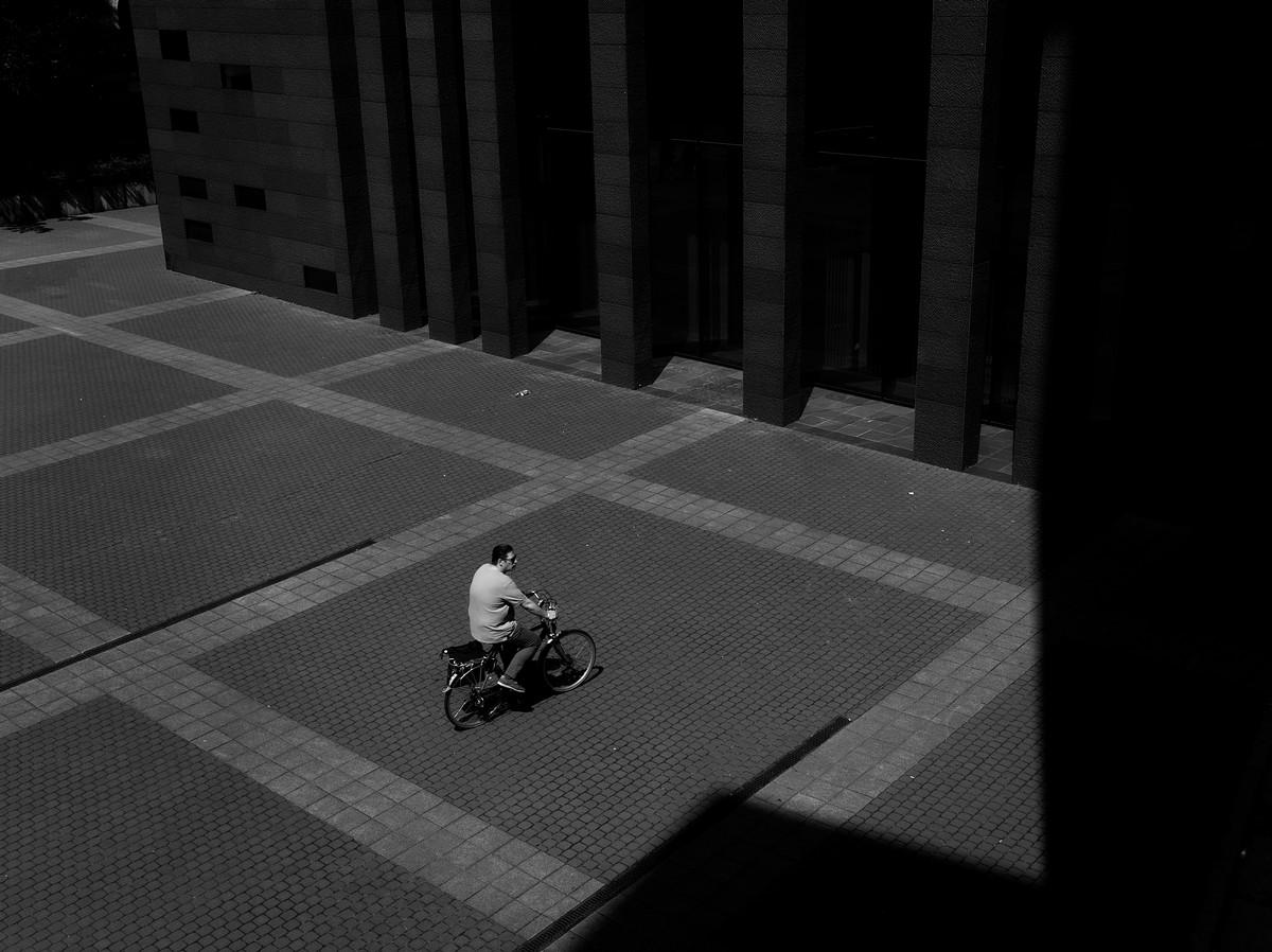 Belgen op fiets en foto